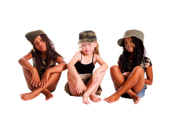 Inter-racial trio of young girls sitting on the floor