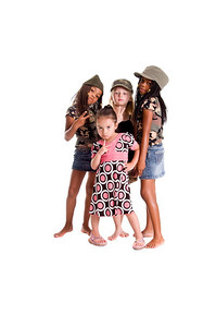 Multi-racial group of young girls dressed in skirts, dresses and military woodland camouflage tops and caps flashing peace signs