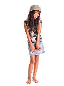 Shy little African American girls dressed in denim skirt and military woodland camouflage top and hat
