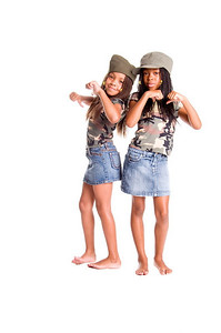 Two little African American girls dressed in denim skirts and military woodland camouflage tops and caps with something to say