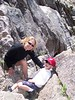 Shannon & Ryan climbing rocks in the Sandias; April 2004
