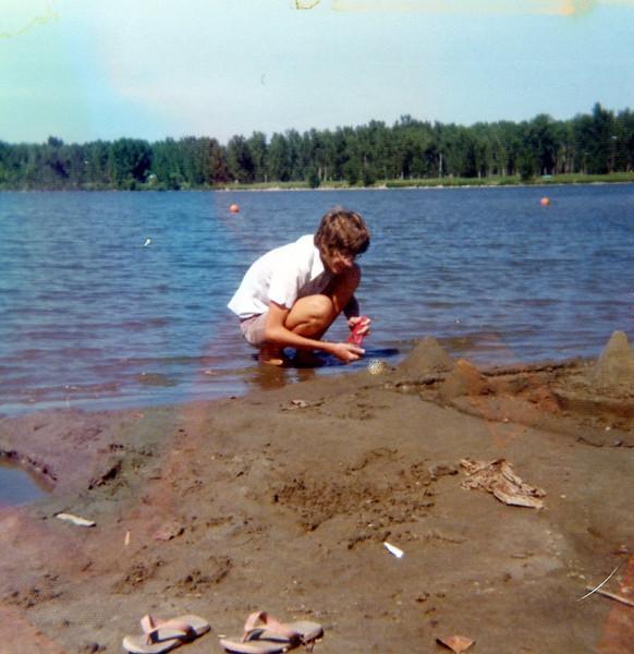Soren building a sandcastle.<br /> 1975