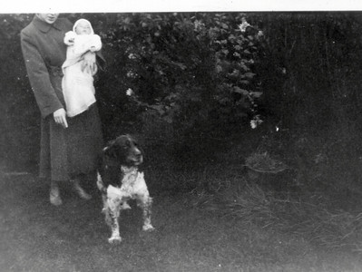 DPB-23: May (Maisie) Barr holding son David with Paddy the dog  at her feet
