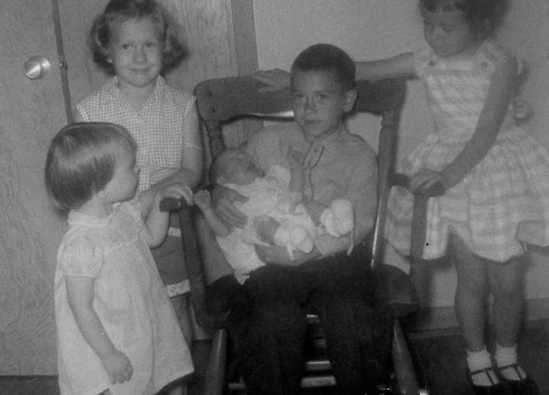 Susan, Patrice, Mark holding Jennifer, Bridget
