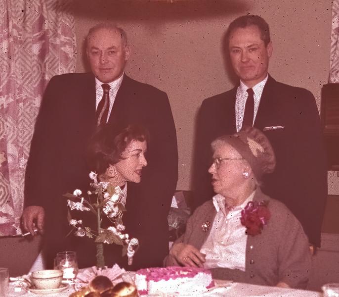 Ronald and Edwin standing behind sister, Harriett and mother, Harriett