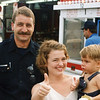 Brady and officer who removed his stuck thumb from the Ferris Wheel ride - 1998