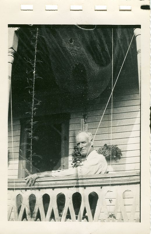 Jesse Holbrook seated on the porch of his home in Owsley County Kentucky.  circa 1930
