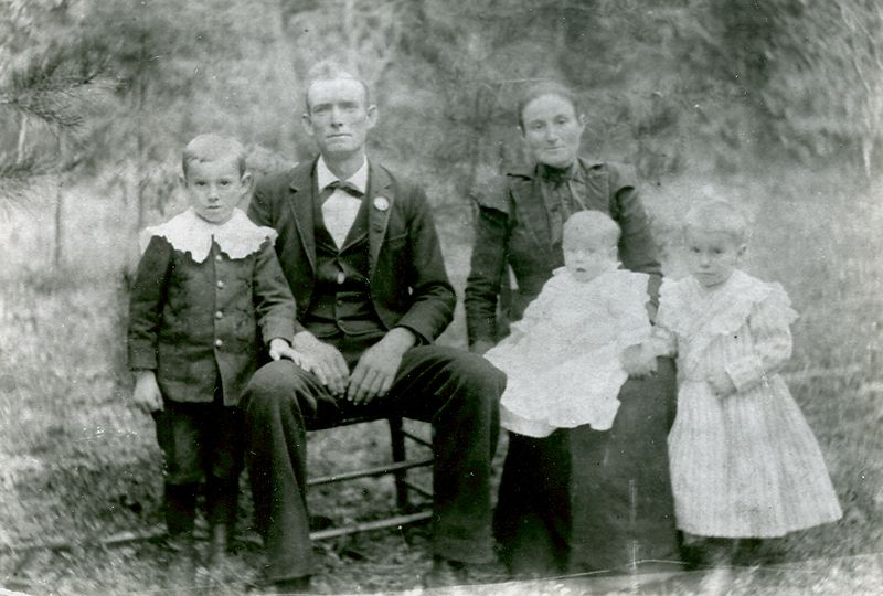 Jesse and Charlotte Holbrook with Clayton, Levada, and Burton taken in 1901. Their fourth child Charlie was born in 1904.