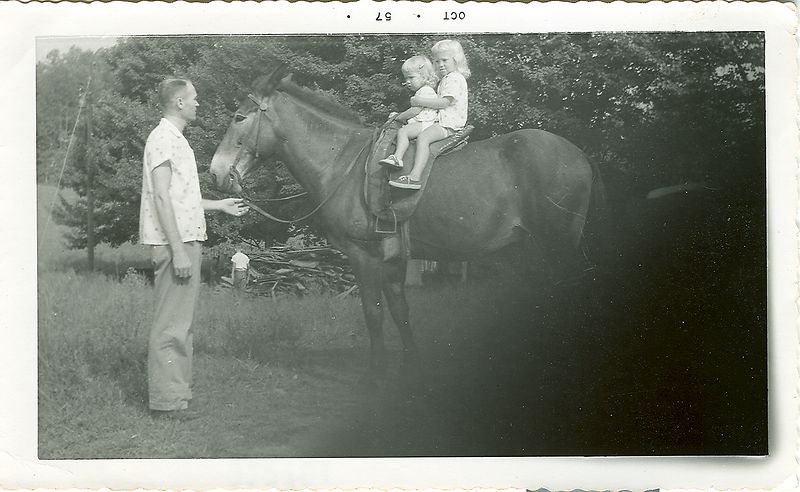 Irene's husband Glen Reyonolds and their two daughters Janie and Nancy.   1957