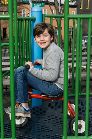 Ethan, are you a little big for that tricycle?