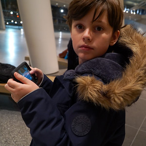 Ethan at the Brooklyn Museum. He's using my phone as a remote to operate the camera which I'm holding. Then he snapped this picture of himself.
