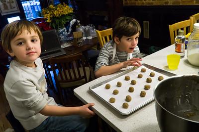 Making peanut butter / Hershey Kiss cookies with their grandma.