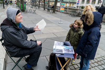A poet read some of his work to Ethan and Sammy. He was selling his books in front of the library.