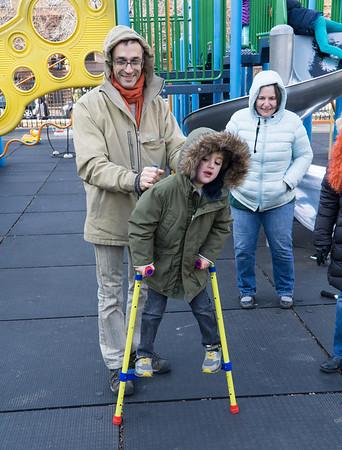 Sammy gets a lesson on stilting. Diane looks on.