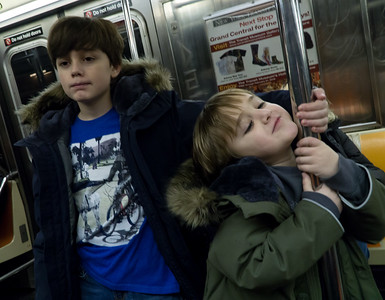 Cute kids on the subway.