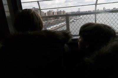 Looking out at the East River on the Manhattan Bridge.