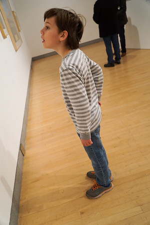"""Ethan, checing out the amazing photos at the """"Shooting Sports"""" photogrpahy exhibit at the Brooklyn Musuem."""