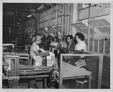 Mom working at Lever Brothers while Uncle Joe and Aunt Nellie came through on a plant tour.  Before Mom married Dad but don't know year.