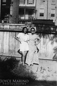 Mom and Aunt Chris in their back yard on Valley Street in Baltimore in1942.
