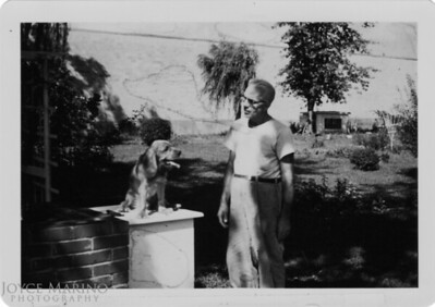 Dad's Dad and his dog at his home in Philadelphia.  Location and Date:  Unknown.