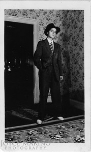 Mom  dressed like a man for a Halloween party!   She was 16 years old so it was shot in 1940.