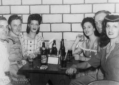 (right to left) Mom, don't know the guy, Aunt Chris and Aunt JoAnn/Therese.  Don't know the next guy but the guy on the right may be Uncle Phil.  Don't know know location or date shot.