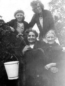 DPB-113: May (Maisie) & Florence (Florie) McKeown (rear), Emily (Granny)  McKeown and Mrs McDonald (front). With no running water it was fetched from the pump each day.