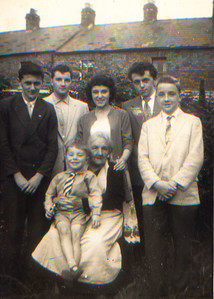 DPB-07: Emily (Granny) McKeown with David Barr on knee. Kenneth Gorman, Billy Patterson, Barbara and Trevor Gorman and Jimmy Patterson 1959 at 203 Cupar Street