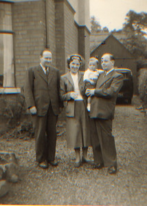 DPB-21: Robert (Bertie) Barr, May (Maisie) Barr (nee McKeown) and David Barr Snr holding David  at 187 Sandown Road, Belfast in 1954