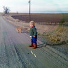 Seth with Norman on the gravel road headed west from the Parsonage<br /> 1972?