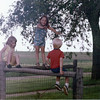 John & Carol visit with their children, Mike and Lauren.<br /> Christine on corner post.<br /> summer 1971