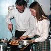 Sayre and Bonnie cooking in the Parsonage.
