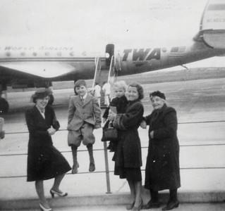 DPB-48 : May (Maisie) McKeown, William (Billy) Patterson, James (Jimmy) Patterson, Anne Patterson (nee MvKeown), May (Maisie) McKeown and Emily (Granny) McKeown at Shannon Airport in 1947