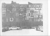 Bloom's Photo Supply was the business owned by Naomi's Dad Jack, and her Uncles (his brothers) Herman and Paul.  In the early '50s, Paul Bloom had the idea of putting ads up on the side of the building that faced the parking lot.  He sold the ad space to Bloom's suppliers.  The result was this.