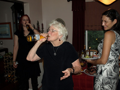 Grandma's first slug of beer from a bottle