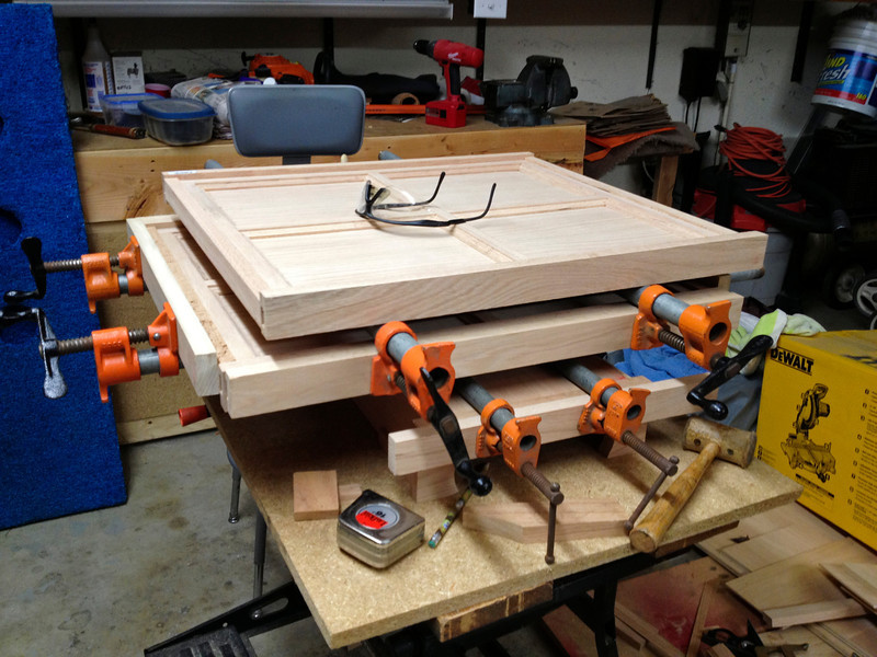 The first glued panel sits atop of the second one that's being glued.