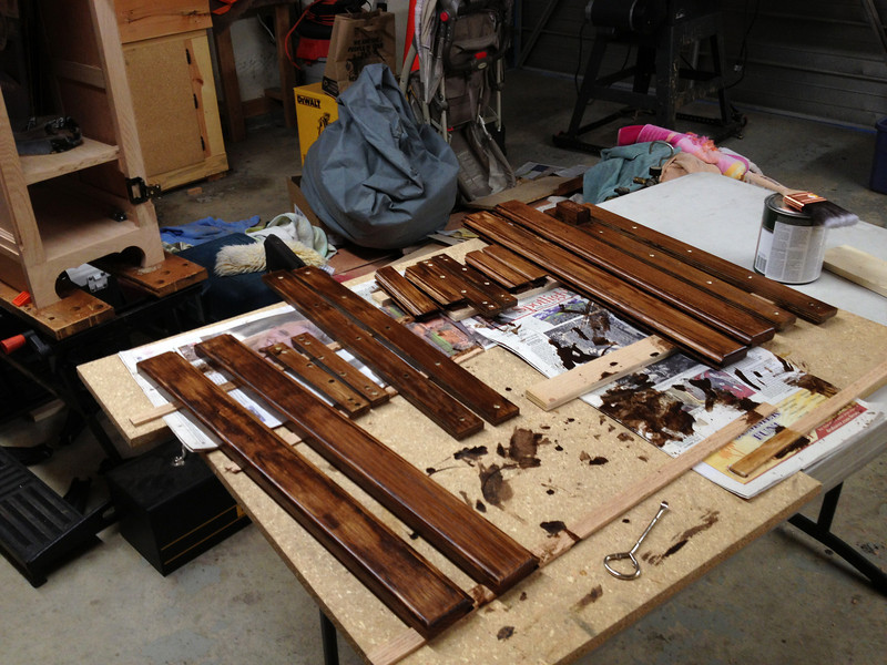 The front and rear cabinet doors disassembled, stained, and finished.