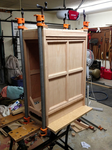 After 1 week of construction, the pieces are coming together in the shape of a cabinet.