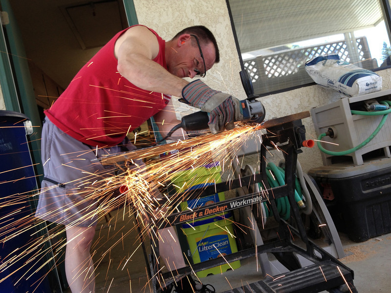 """Me cutting (2) rectangles to size from the sheet of expanded steel with a 4"""" grinder."""