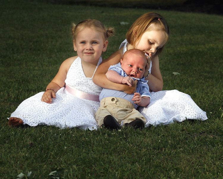 Eden, Sterling and Liberty sit on the grass at Whispering Willows Park in Conyngham Saturday, June 23, 2007.