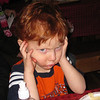 Ben didn't like the awesome madrigal carolers - he plugged his ears.