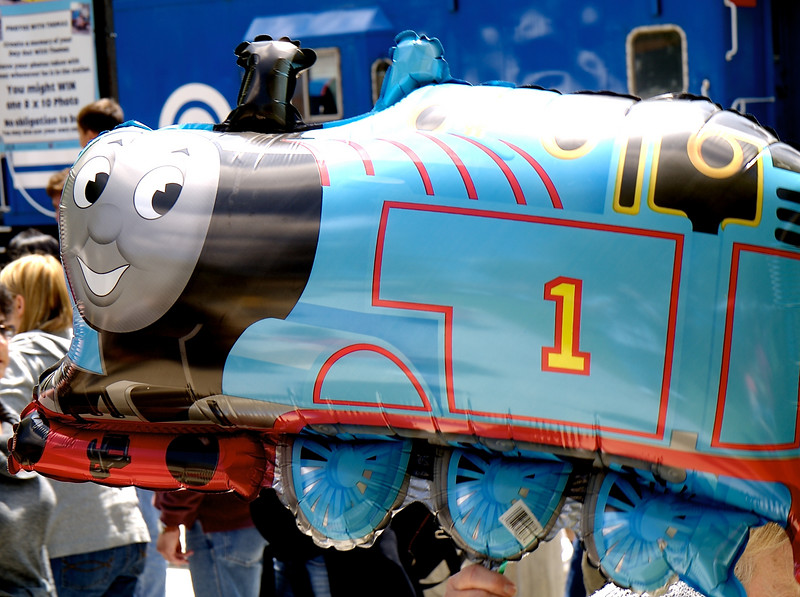 A man sold Thomas the Train balloons.