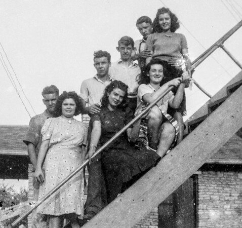 Thompson Friends on a ladder.