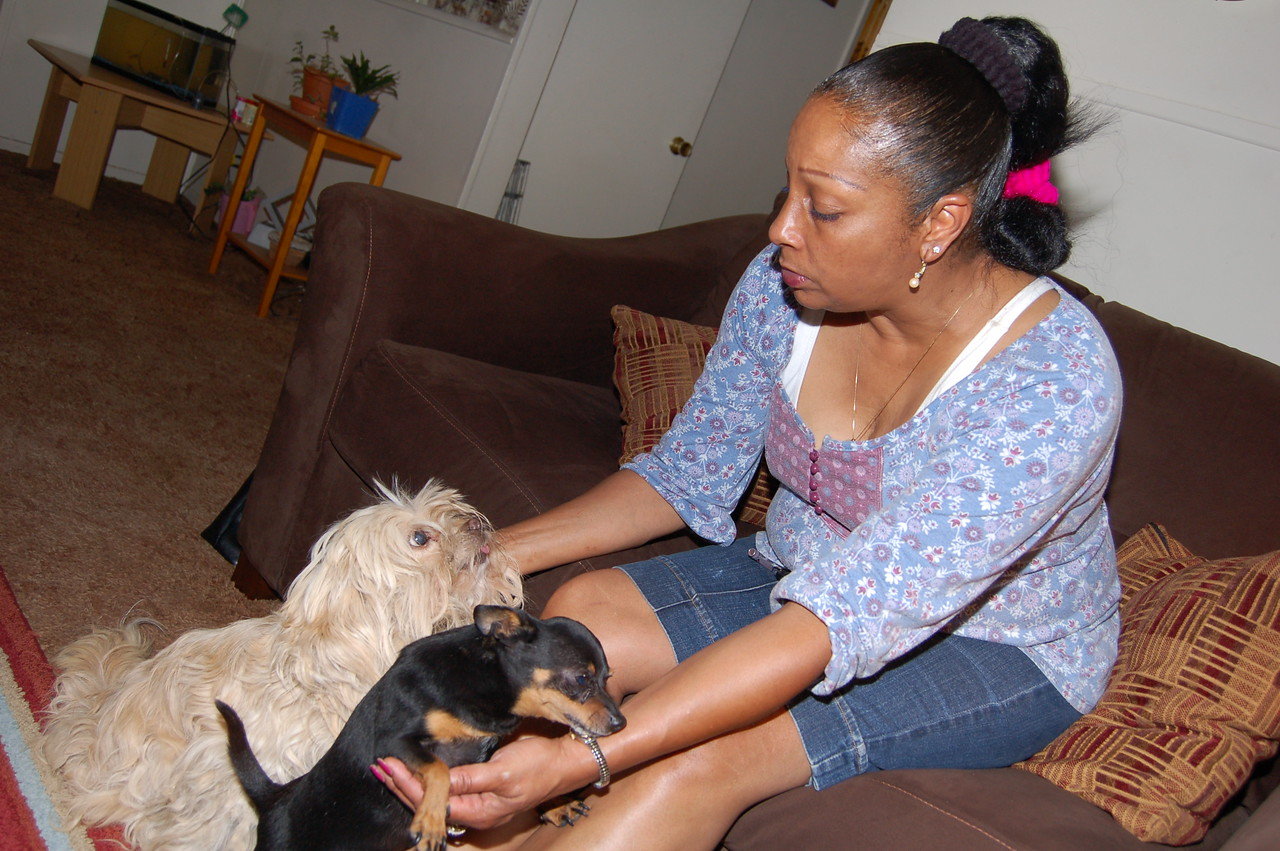 Melissa and two of her three pooches.