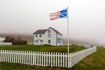 Tickle Inn at Cape Onion and provincial flag in a stiff breeze