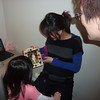 Tiffany presenting Mother's Day gift to Linh.  May 2011
