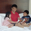 Uncle Dennis reading story to Tiffany and Gavin.
