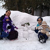 Tiffany and Baby Hayden, with Grandparents and snowman.  2012 Feb.