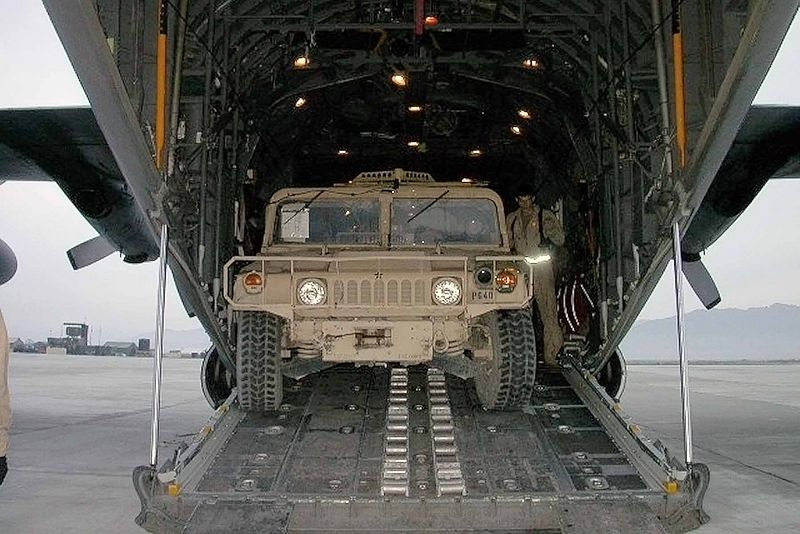 A Humvee being loaded onto a C130 - May 2005