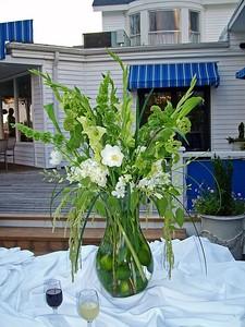 Flower arrangement on serving table